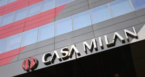 """A picture shows the logo of """"Casa Milan"""", the AC Milan's headquarters hosting a shop and a museum dedicated to the Serie A football club, on April 14, 2017 before a press conference of Chinese investors """"Rossoneri Sport Investment Lux"""" in Milan. Serie A giants AC Milan were sold to Rossoneri Sport Investment Lux yesterday in a deal which sees the Chinese-led consortium take a 99.9% stake in the club. The seven-time European champions who are Italy's most succcessful club in international competition, have been owned by former three-time Italy prime minister Silvio Berlusconi since 1986. A joint statement by AC Milan's holding company Fininvest and Rossoneri Sport Investment Lux said on April 13, 2017 : """"Today Fininvest has completed the sale of the entire stake owned in AC Milan - equal to 99.93% - to Rossoneri Sport Investment Lux."""" / AFP PHOTO / MIGUEL MEDINA (Photo credit should read MIGUEL MEDINA/AFP/Getty Images)"""
