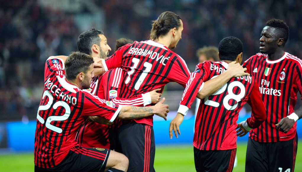 MILAN, ITALY - MARCH 24: Zlatan Ibrahimovic of Milan celebtaes with team-mates after scoring his first goal during the Serie A match between AC Milan and AS Roma at Stadio Giuseppe Meazza on March 24, 2012 in Milan, Italy. (Photo by Dino Panato/Getty Images)