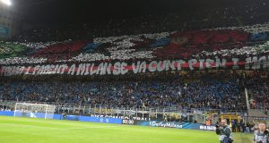 MILAN, ITALY - OCTOBER 21: The AC Milan fans show their support prior to the Serie A match between FC Internazionale and AC Milan at Stadio Giuseppe Meazza on October 21, 2018 in Milan, Italy. (Photo by Emilio Andreoli/Getty Images)