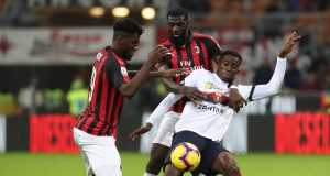 MILAN, ITALY - OCTOBER 31: Christian Kouame of Genoa CFC competes for the ball with Tiemoue Bakayoko and Franck Kessie (L) of AC Milan during the serie A match between AC Milan and Genoa CFC at Stadio Giuseppe Meazza on October 31, 2018 in Milan, Italy. (Photo by Marco Luzzani/Getty Images)