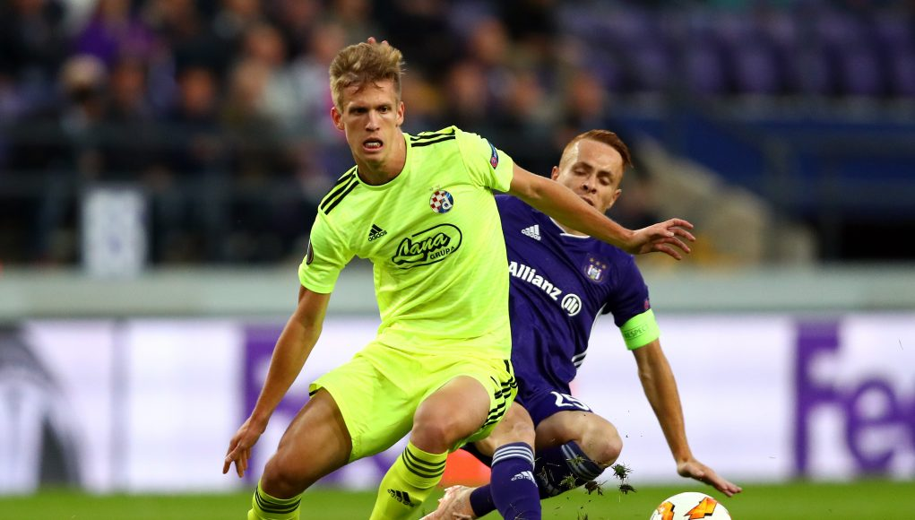 BRUSSELS, BELGIUM - OCTOBER 04: Adrien Trebel of RSC Anderlecht tackles Dani Olmo of Dinamo Zagreb during the UEFA Europa League Group D match between RSC Anderlecht and Dinamo Zagreb at Constant Vanden Stock Stadium on October 4, 2018 in Brussels, Belgium. (Photo by Dean Mouhtaropoulos/Getty Images)