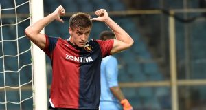 GENOA, GE - AUGUST 11: Krzsysztof Piatek of Genoa celebrate after 3-0 during the Coppa Italia match between Genoa CFC and Lecce at Stadio Luigi Ferraris on August 11, 2018 in Genoa, Italy. (Photo by Paolo Rattini/Getty Images)