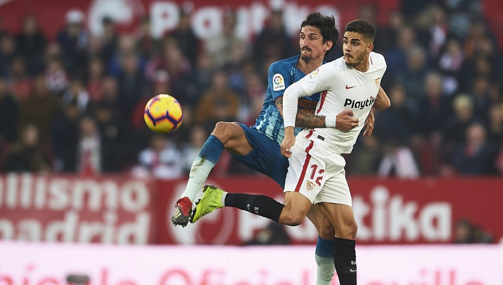 SEVILLE, SPAIN - JANUARY 06: Stefan Savic of Club Atletico de Madrid (L) competes for the ball with Andre Silva of Sevilla FC (R) during the La Liga match between Sevilla FC and Club Atletico de Madrid at Estadio Ramon Sanchez Pizjuan on January 06, 2019 in Seville, Spain. (Photo by Aitor Alcalde/Getty Images)