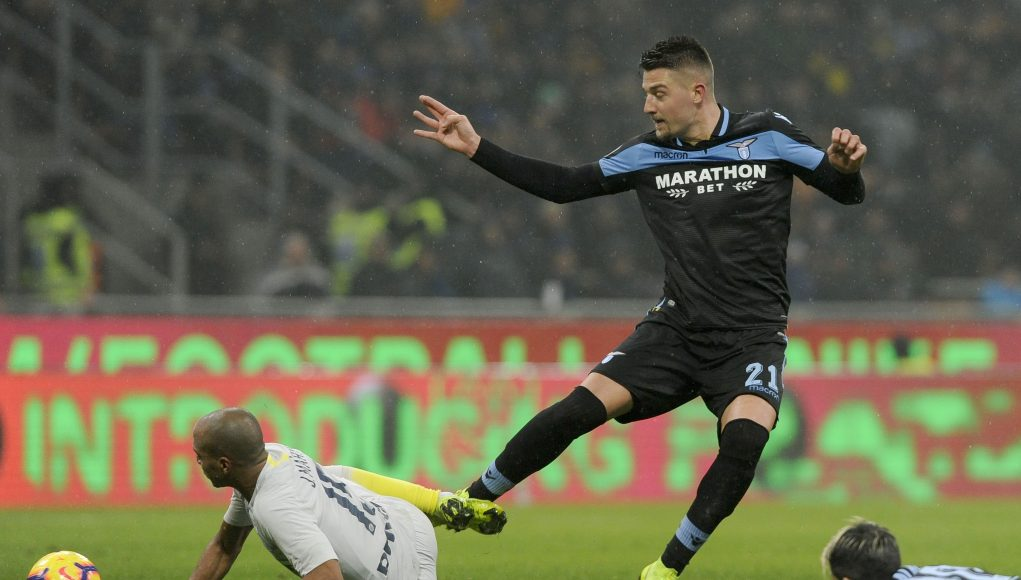 MILAN, ITALY - JANUARY 31: Sergej Milinkovic Savic of SS Lazio compete for the ball with Joao Mranda of FC Internazionale during the Coppa Italia match between FC Internazionale and SS Lazio at Stadio Giuseppe Meazza on January 31, 2019 in Milan, Italy. (Photo by Marco Rosi/Getty Images)