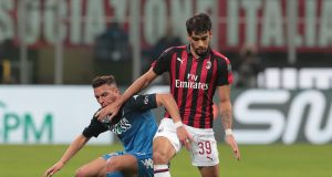MILAN, ITALY - FEBRUARY 22: Lucas Paqueta of AC Milan is challenged by Ismael Bennacer of Empoli FC during the Serie A match between AC Milan and Empoli at Stadio Giuseppe Meazza on February 22, 2019 in Milan, Italy. (Photo by Emilio Andreoli/Getty Images)
