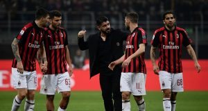 AC Milan's Italian coach Gennaro Gattuso (C) talks with (From L) AC Milan's Italian defender Alessio Romagnoli, AC Milan's Italian forward Patrick Cutrone, AC Milan's Italian forward Fabio Borini and AC Milan's Swiss defender Ricardo Rodriguez at the end of the Italian Serie A football match AC Milan vs Empoli on February 22, 2019 at the San Siro stadium in Milan. (Photo by MARCO BERTORELLO / AFP) (Photo credit should read MARCO BERTORELLO/AFP/Getty Images)