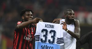 AC Milan's Ivorian midfielder Franck Kessie and AC Milan's French midfielder Tiemoue Bakayoko hold the jersey of Lazio's Italian defender Francesco Acerbi at the end of the Italian Serie A football match AC Milan vs Lazio Rome on April 13, 2019 at the San Siro stadium in Milan. (Photo by Miguel MEDINA / AFP) (Photo credit should read MIGUEL MEDINA/AFP/Getty Images)