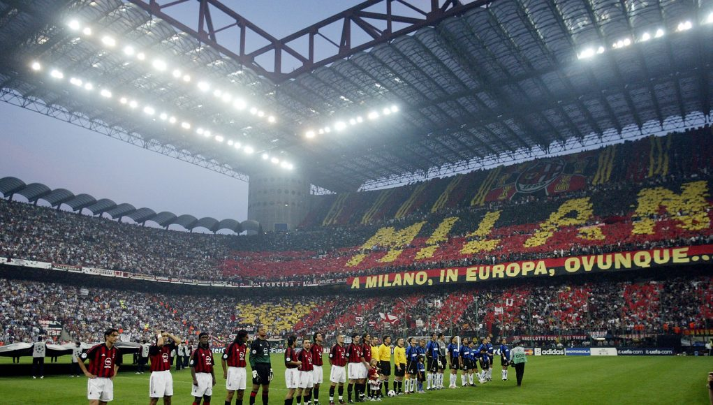 MILAN - MAY 7: AC Milan and Inter Milan players line-up in front of an amazing atmosphere before the UEFA Champions League Semi-Final First Leg match between AC Milan and Internazionale Milano held on May 7, 2003 at the Guiseppe Meazza San Siro, in Milan, Italy. The match ended in a 0-0 draw. (Photo by Michael Steele/Getty Images)