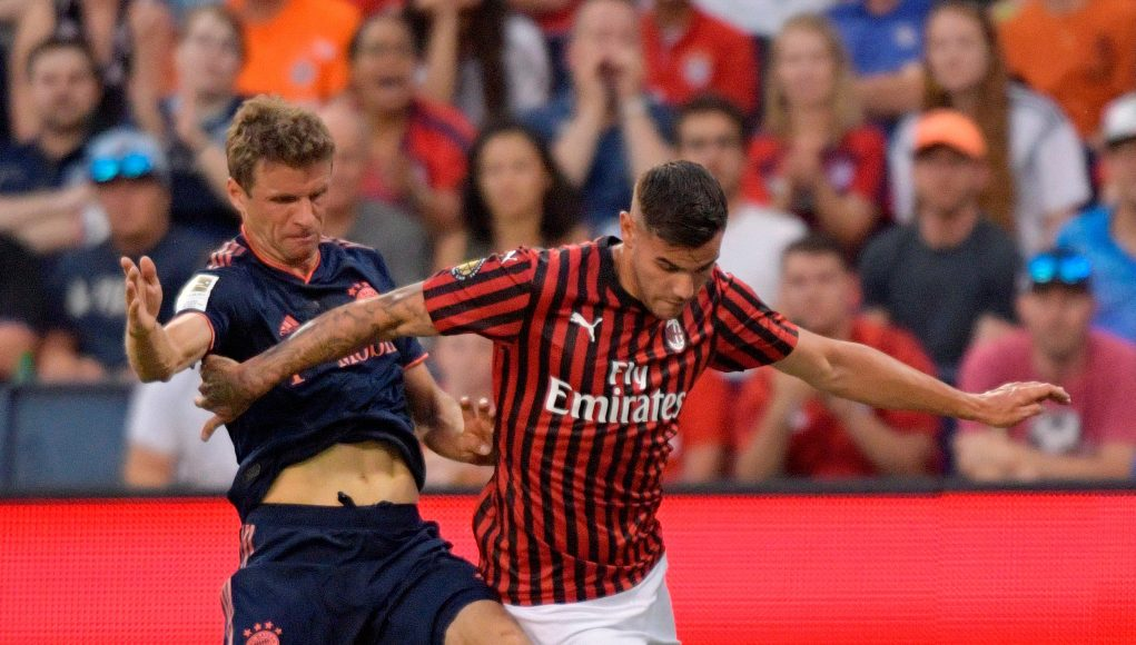 Bayern Munich's Thomas Muller (L) fights for the ball with Milan's Theo Hernandez during their International Champions Cup football match between Fc Bayern and AC Milan at Children's Mercy Park in Kansas City, Kansas on July 23, 2019. (Photo by Tim VIZER / AFP) (Photo credit should read TIM VIZER/AFP/Getty Images)