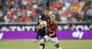 KANSAS CITY, MISSOURI - JULY 23: Benjamin Pavard of FC Bayern Muenchen battles for the ball with Samu Castillejo of AC Milan during the 2019 International Champions Cup match between FC Bayern and AC Milan at Children`s Mercy Park Stadium on July 23, 2019 in Kansas City, Missouri. (Photo by Alexander Hassenstein/Bongarts/Getty Images)